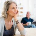Woman looking sad with husband in background - Have you forgotten how to be intimate? - Diet&wellbeing - allaboutyou.com