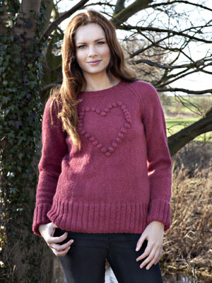 Woman wearing a knitted heart bobble jumper - Knit a bobbled heart jumper: free knitting pattern - Craft - allaboutyou.com