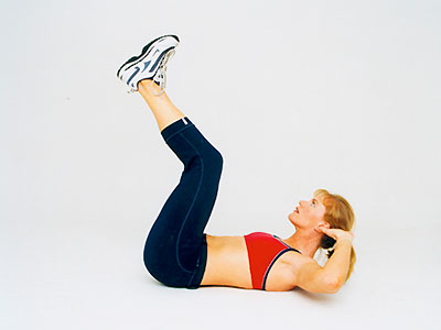 Woman with legs in air - Get fab abs: 5 easy stomach exercises - Exercise - Diet & wellbeing - allaboutyou.com