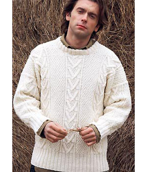 man wearing knitted Aran jumper