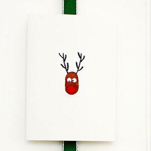 Make a thumbprint reindeer christmas card christmas for Reindeer christmas card craft