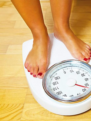 123 woman's feet on scales - Want to lose weight? Try the best diets here - Diet & wellbeing - allaboutyou.com