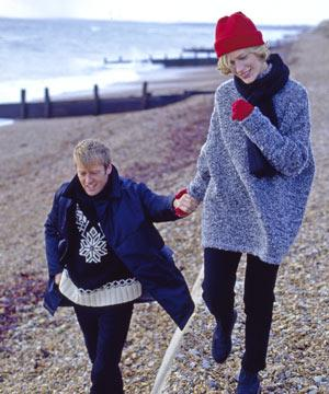 couple holding hands on winter beach - The UK's most romantic places - Country & travel - allaboutyou.com