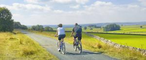 couple cycling Tissington Trail, Derbyshire