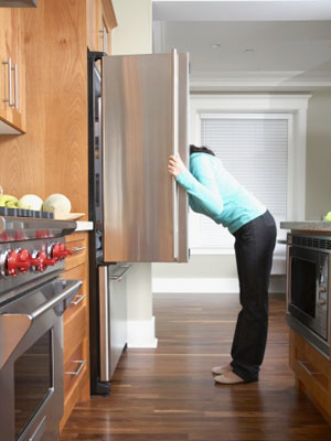 Woman looking in fridge - Crack the 5:2 diet and beat the bulge - Diet&wellbeing - allaboutyou.com